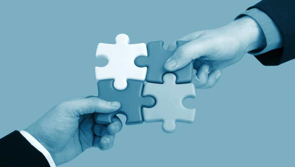 Building business partnerhips partnering puzzle hands strategic alliances